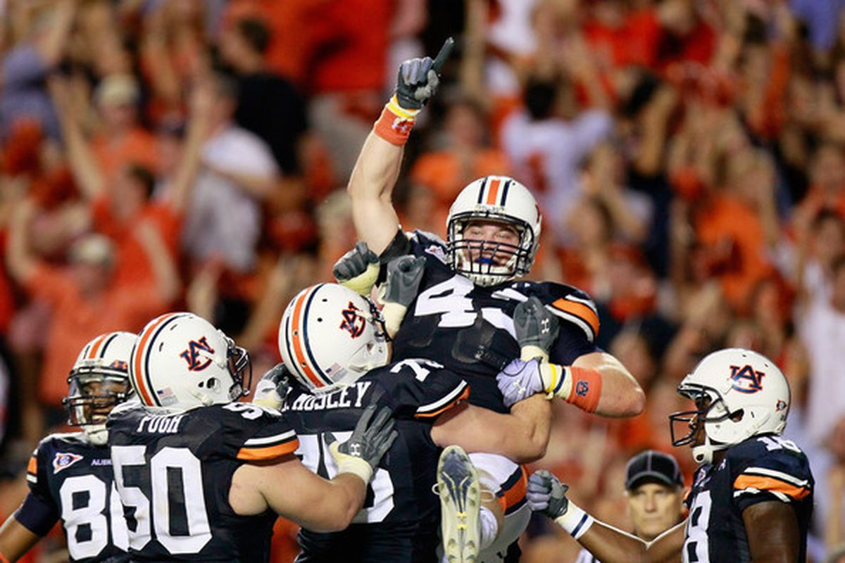 Auburn's Philip Lutzenkirchen (43) celebrates with teammates after catching the go-ahead touchdown against South Carolina on September 25, 2010 in Auburn, Alabama.  (<em>photo: getty images-Kevin C. Cox</em>)