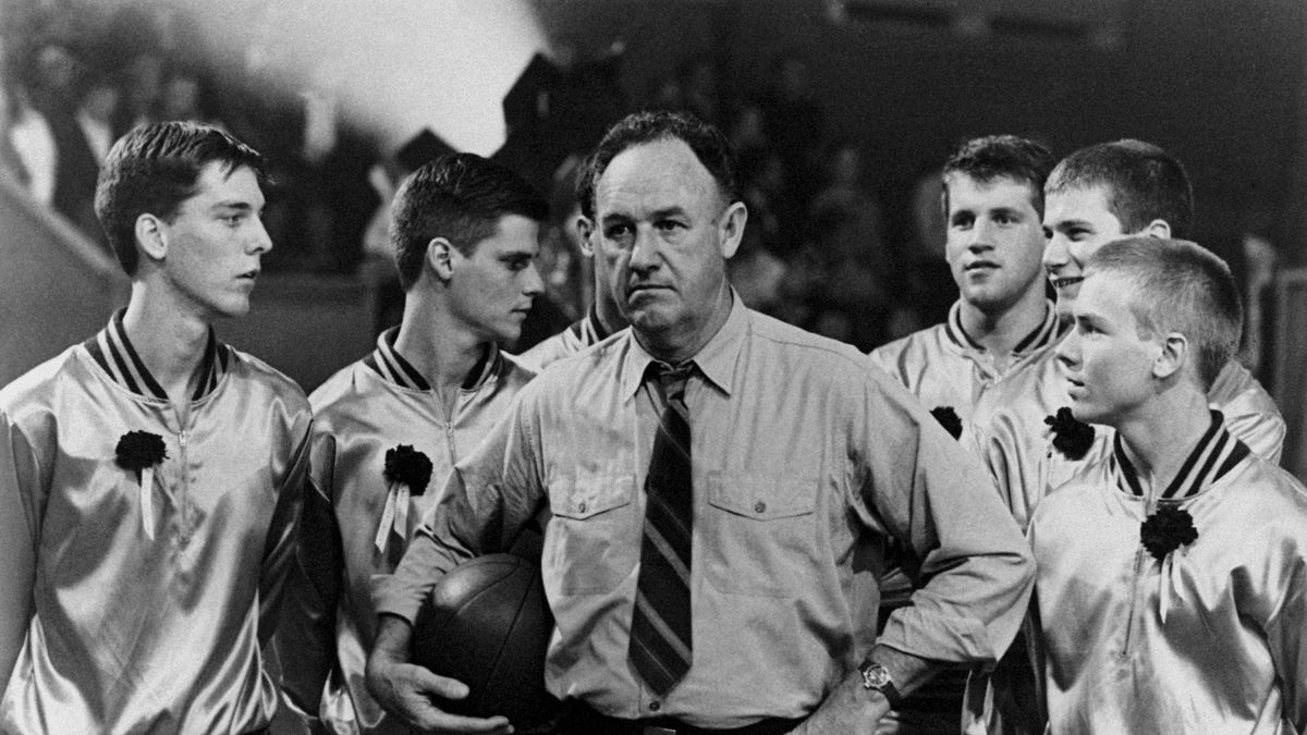 Gene Hackman surrounded by young basket players