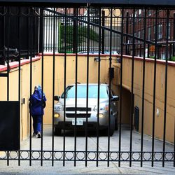 Embassy staff back a van into the underground garage at the Iranian embassy in Ottawa, Friday Sept.7, 2012.  The Canadian government says it is shutting its embassy in Tehran and severing diplomatic relations amid recent attacks on foreign diplomats in Iran. Foreign Affairs Minister John Baird said Friday that the Canadian embassy in Tehran will close immediately and Iranian diplomats in Canada have been given five days to leave. He says he's worried about the safety of diplomats in Tehran following recent attacks on the British embassy there. He's also warning Canadians to avoid traveling to Iran.