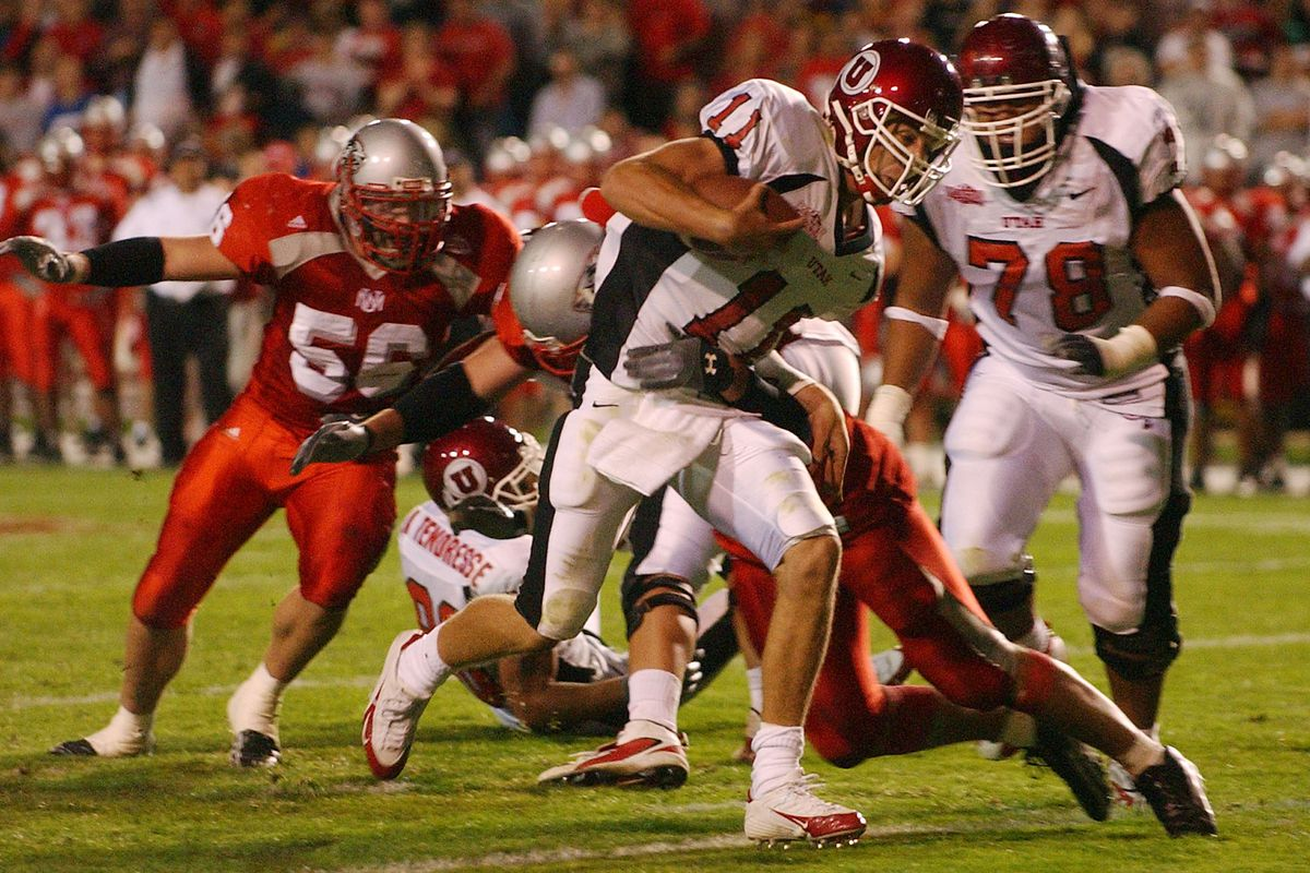 Alex Smith of the University of Utah fights his way in for a touchdown. University of Utah vs. University of New Mexico college football in Albuquerque, New Mexico. Mountain West Conference. Oct 1, 2004 by Ravell Call, Deseret Morning News (Submission date: 10/01/2004)
