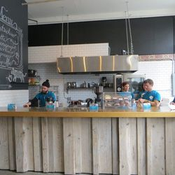 """The coffee bar serves espresso drinks, drip coffee, and a small selection of pastries, and all of it's for free. The coffee comes from a """"local vendor."""" Purina won't say who, but rumor has it that it's a popular Brooklyn roaster."""