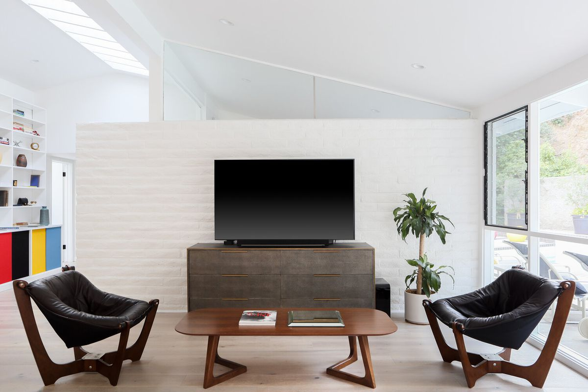 A white room with clerestory windows and a wall of windows.