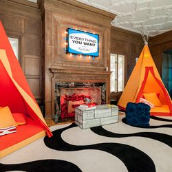 """This pair of orange teepees use lucite rods instead of wood to hold them up. [Photo by <a href=""""http://www.patriciachangphotography.com/"""">Patricia Chang</a>]"""