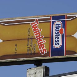 A Hostess Twinkies sign is shown at the Utah Hostess plant in Ogden, Utah, Thursday, Nov. 15, 2012. Hostess Brands Inc. is warning striking employees that it will move to liquidate the company if plant operations don't return to normal levels by Thursday evening.