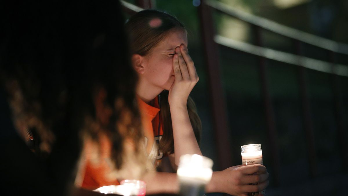 Sherie Gramlich cries during a Saturday vigil for victims of a mass shooting earlier in the day at a Walmart store in El Paso, Texas.