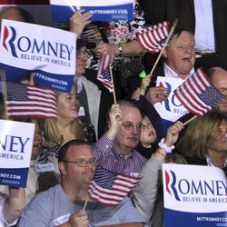 Supporters of Republican presidential candidate, former Massachusetts governor Mitt Romney cheer as they wait for his arrival Tuesday, April 24, 2012 in Manchester, N.H. (AP Photo/Jim Cole)
