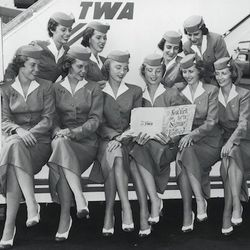 "TWA's uniform update in the 50s. Photo via <a href-""http://www.twaflightattendants.com/liftoffhtml/1930.html"">TWAFlightAttendants.com.</a>"