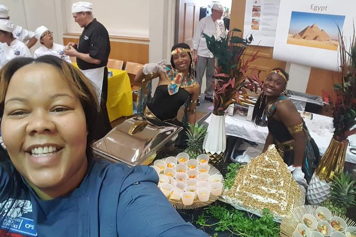 Golden Apple Award finalist Athenia Travis takes a selfie with her culinary arts students at Southside Occupational Academy. She and her students sometimes prepare meals from cultures across the world for the whole school to enjoy.