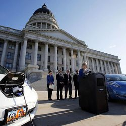 Cheryl Loveless, electric vehicle owner, speaks during a press briefing concerning alternative fuel vehicle strategies at the Capitol in Salt Lake City, Wednesday, Aug. 7, 2013.