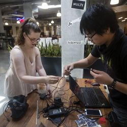 Virginia Caynak, left, and Conan Zhang set up a demonstration of a virtual reality experience at the Lassonde Studios on the University of Utah campus in Salt Lake City on Friday, June 23, 2017. Both Caynak and Zhang are a part of the virtual reality startup business Grace Foundry, which sets virtual reality experiences to music.