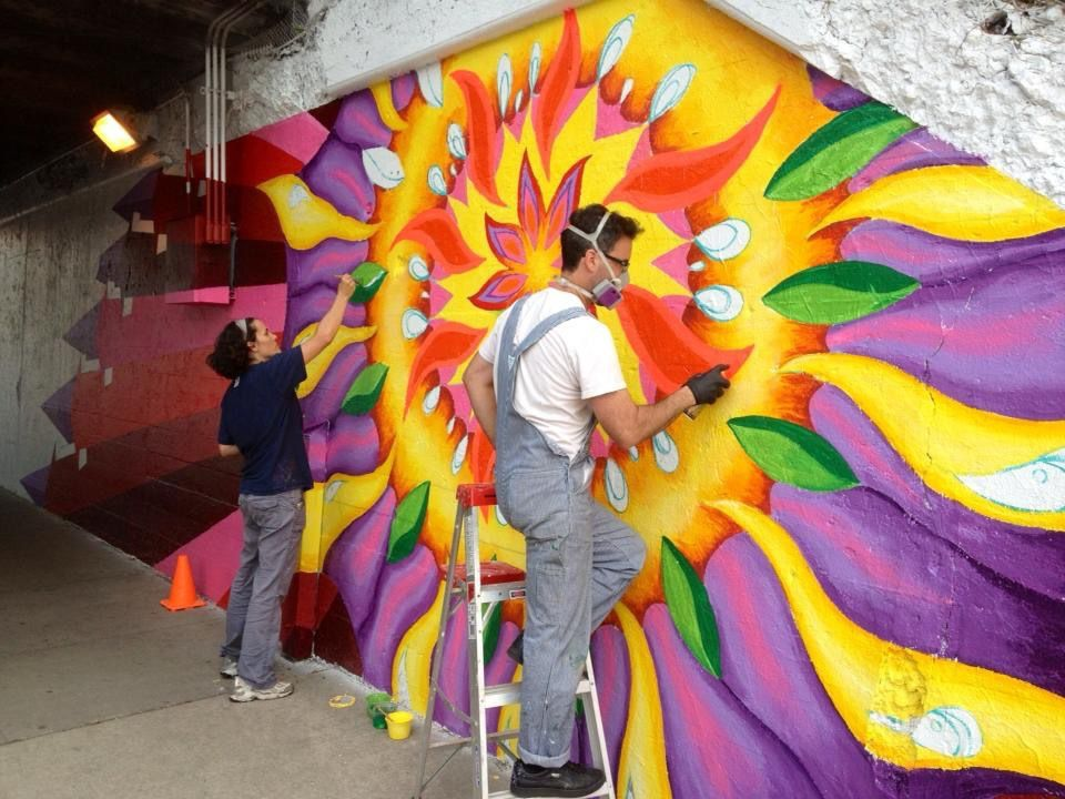Lea Pinsky and Dustin Harris work on one of their murals.