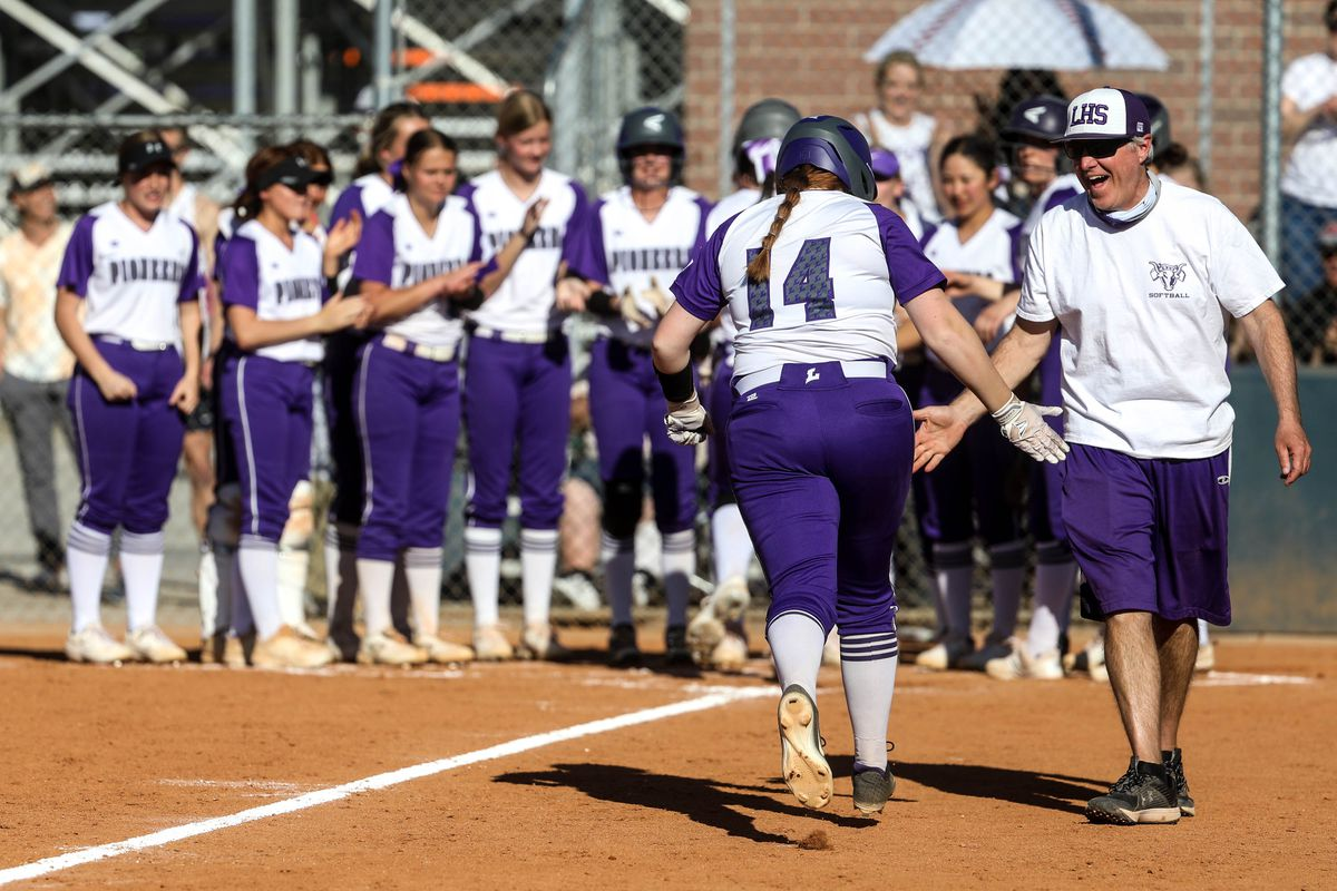 Lehi Pioneers' Halley Payne (14) runs to home after she hit a home run during a high school softball game at Timpanogos High School on Thursday, April 1, 2021.