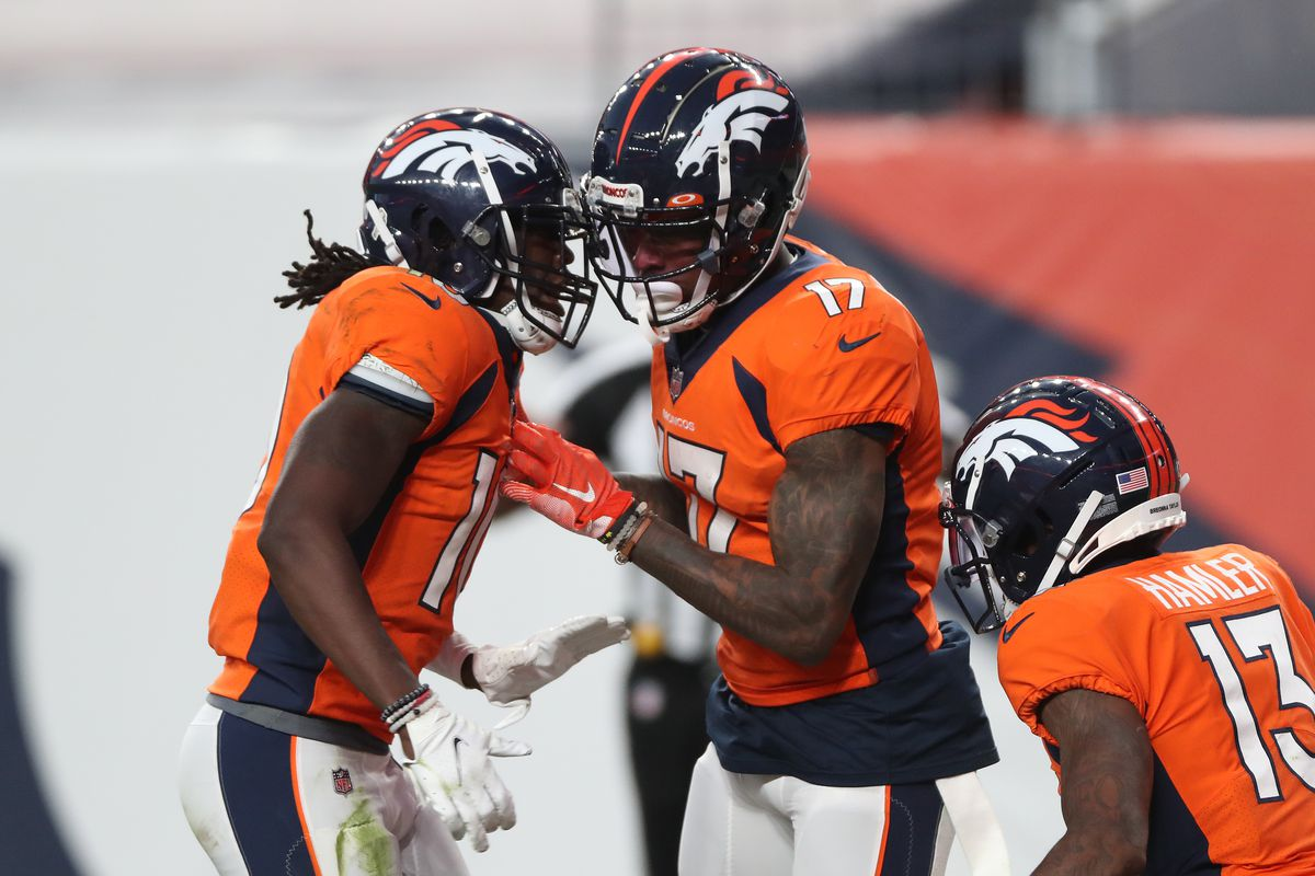DaeSean Hamilton #17 of the Denver Broncos celebrates his touchdown with teammates Jerry Jeudy #10 and KJ Hamler #13 as they take on the Los Angeles Chargers in the fourth quarter of the game at Empower Field At Mile High on November 01, 2020 in Denver, Colorado.
