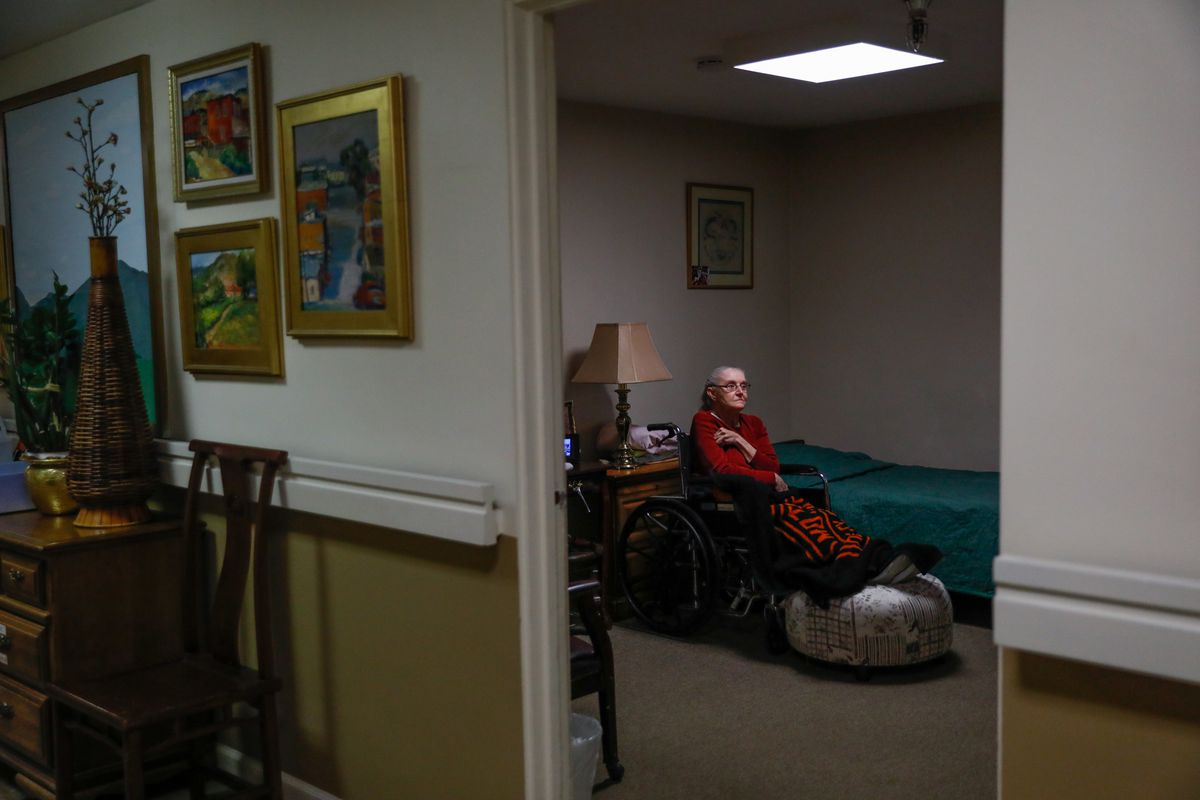 A resident watches television in her room at the Gordon Manor assisted-care facility in Redwood City, California, on January 28, 2021.