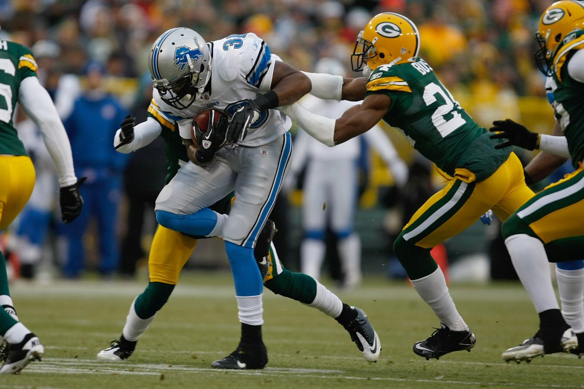 Don Carey #31 of the Detroit Lions runs during the game against the Green Bay Packers at Lambeau Field.