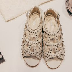 "Eolia Studded Sandals, <a href=""http://us.maje.com/eolia.html?___store=maje"">$495</a>"