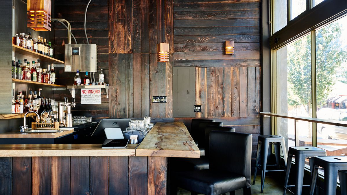 A picture of a burnt-wood bar and seating at Hapa Ramen
