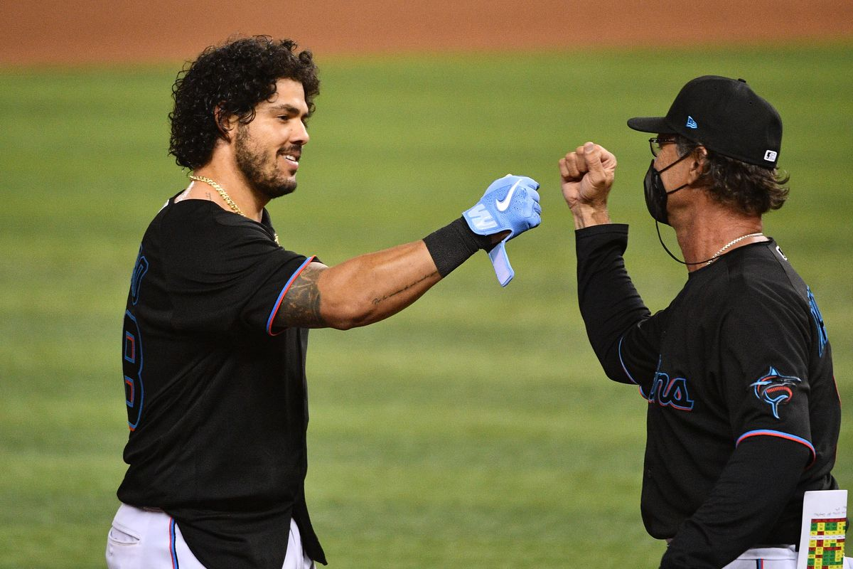 Jorge Alfaro #38 and manager Don Mattingly #8 of the Miami Marlins celebrate defeating the San Francisco Giants in the tenth inning at loanDepot park