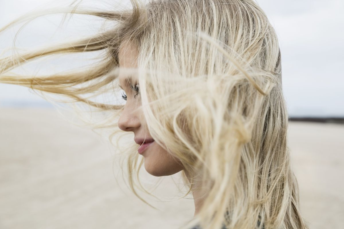 A woman with blonde hair on the beach
