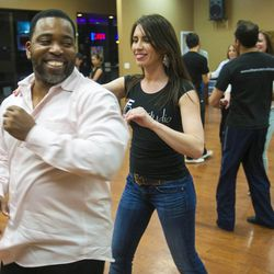 South Salt Lake Businesswoman of the Year Maria Ivanova works with Reggie Alford Tuesday, March 12, 2013, at her dance studio, DF Dance.