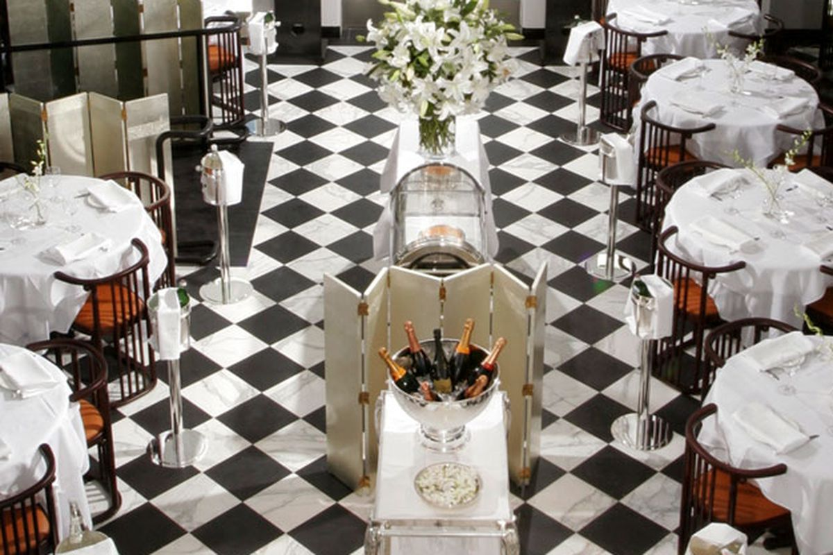 A black and white tiled upscale dinner restaurant.
