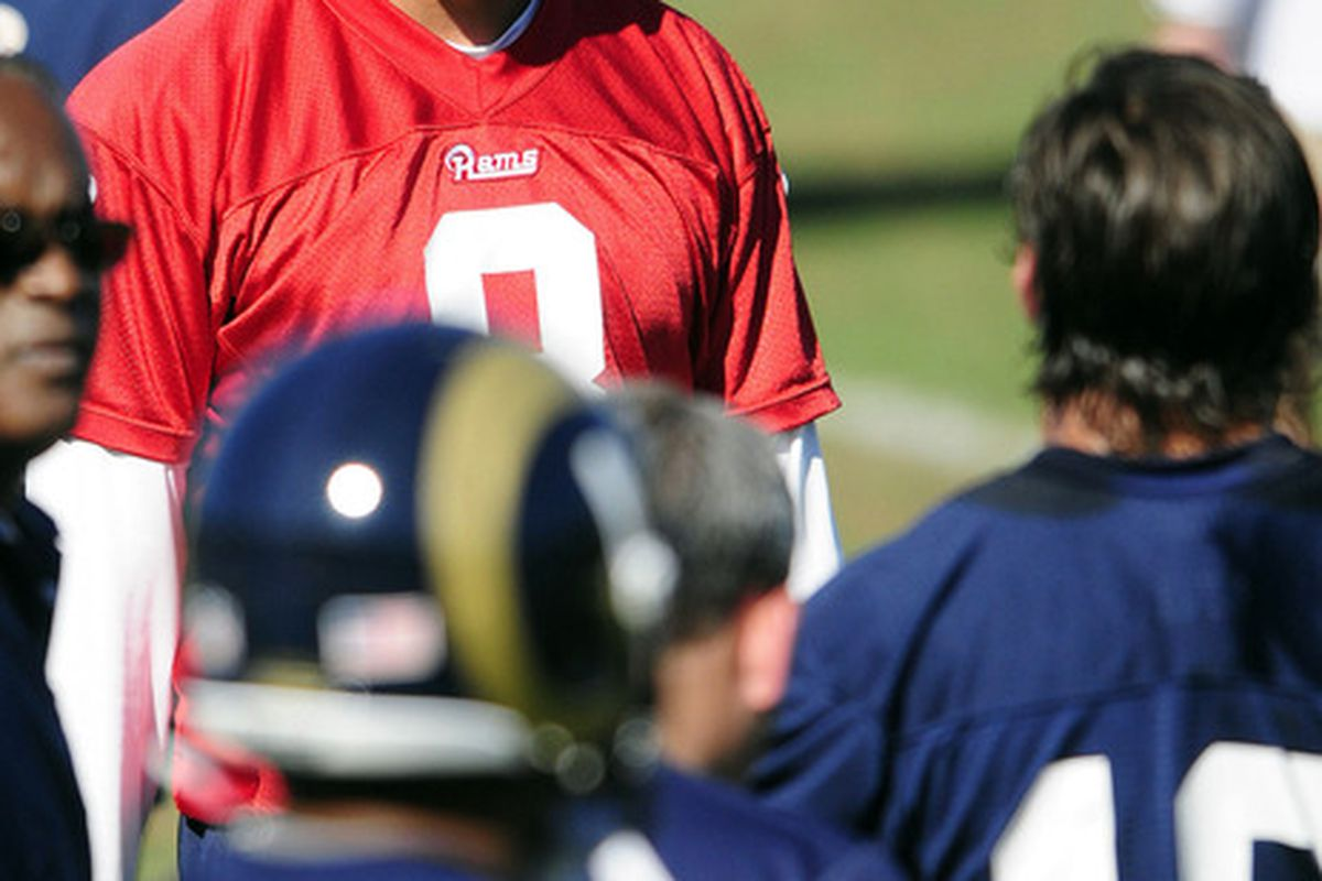 June 12, 2012; St. Louis, MO, USA; St. Louis Rams quarterback Sam Bradford (8) talks with wide receivers during minicamp at ContinuityX Training Center. Mandatory Credit: Jeff Curry-US PRESSWIRE