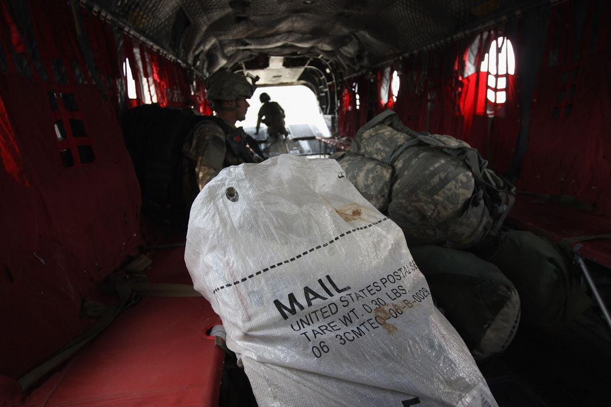 This is the US Mail, on a damn CH-47 Chinook, people! This is now the standard mailbag picture. Forever.