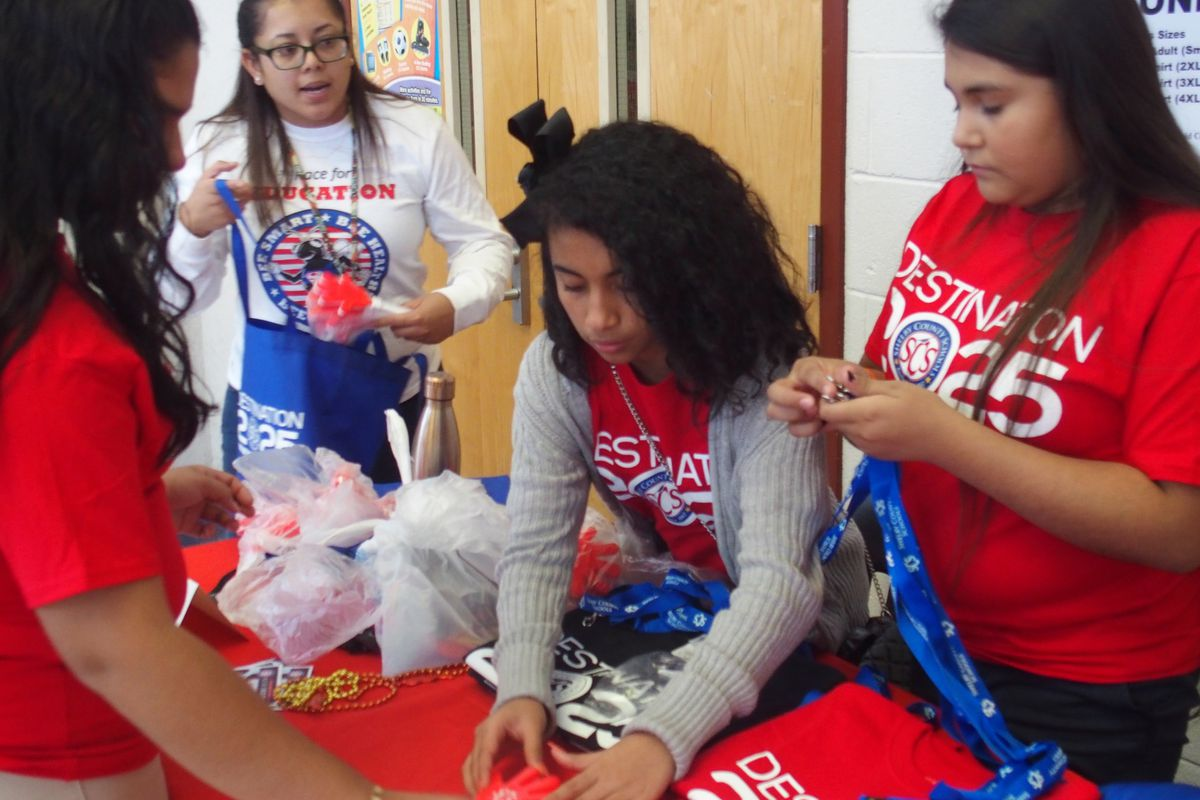 Talia Palacio directs student volunteers at a Hispanic Heritage Month event in October. Palacio is the newly hired specialist handling communication between Shelby County Schools and Memphis' growing Hispanic community.