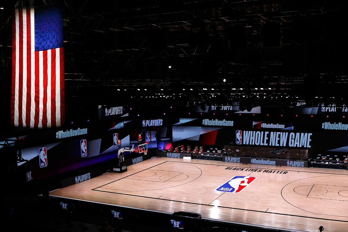 An empty court and bench are shown following the scheduled start time in of Game 5 of an NBA basketball first-round playoff series, Wednesday, Aug. 26, 2020, in Lake Buena Vista, Fla.