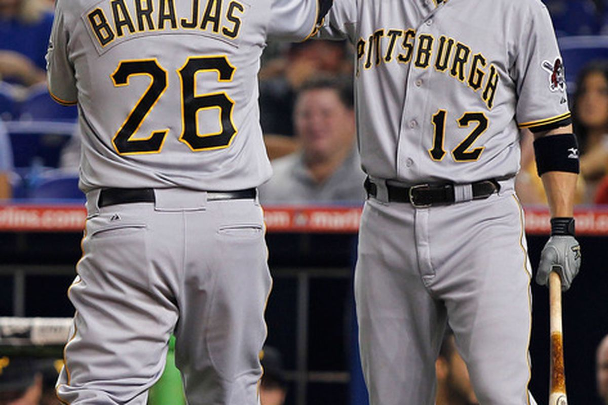 MIAMI, FL - MAY 14: Rod Barajas #26 of the Pittsburgh Pirates celebrates with Clint Barmes #12 after hitting a home run during a game against the Miami Marlins at Marlins Park on May 14, 2012 in Miami, Florida.  (Photo by Sarah Glenn/Getty Images)
