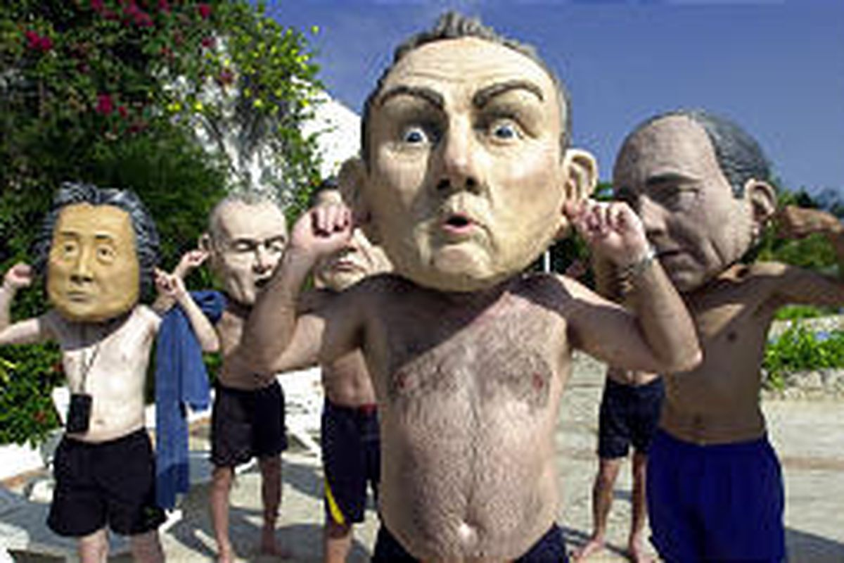 Protesters wearing fiberglass heads of world leaders plug their ears near the Word Trade Organization meeting in Cancun Sunday. Depicted from left are Junichiro Koizumi of Japan, Jean Chretien of Canada, Tony Blair of Great Britain and Jacques Chirac of F
