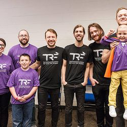 Imagine Dragons smiles with a grantee family that the foundation helps.