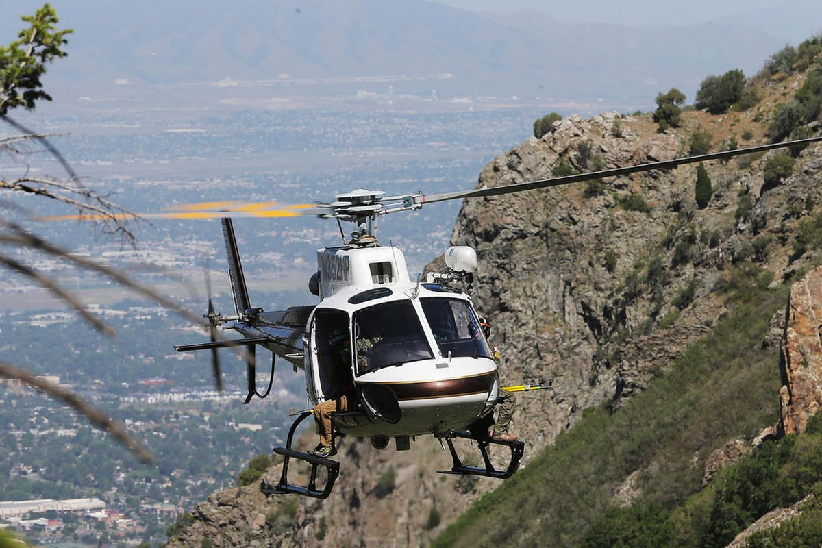 """FILE""""""""The DPS chopper makes an approach to drop off members of the Salt Lake County Search and Rescue team during the recovery of a hiker in Bell Canyon falls on Monday, June 5, 2017."""