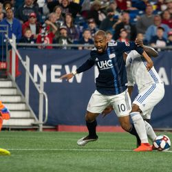 FOXBOROUGH, MA - MAY 11: New England Revolution forward Teal Bunbury #10 is taken down inside the box during the first half against the San Jose Earthquakes at Gillette Stadium on May 11, 2019 in Foxborough, Massachusetts. (Photo by J. Alexander Dolan - The Bent Musket)