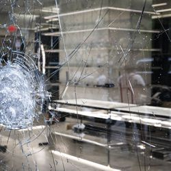 Shelves in a store sit empty after looting broke out overnight in the Gold Coast and surrounding neighborhoods, Monday morning, Aug. 10, 2020.