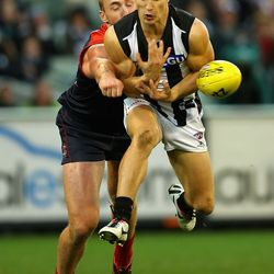 Lynden Dunn of the Demons spoils a mark by Kyle Martin of the Magpies during the round 11 AFL match between the Melbourne Demons and the Collingwood Magpies.