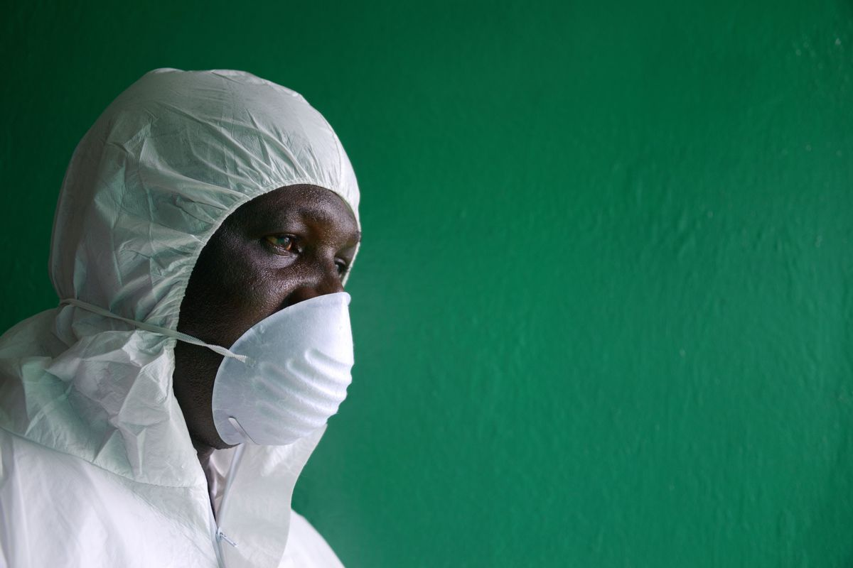A health worker, wearing a protective suit, conducts an ebola prevention drill at the port in Monrovia, Liberia