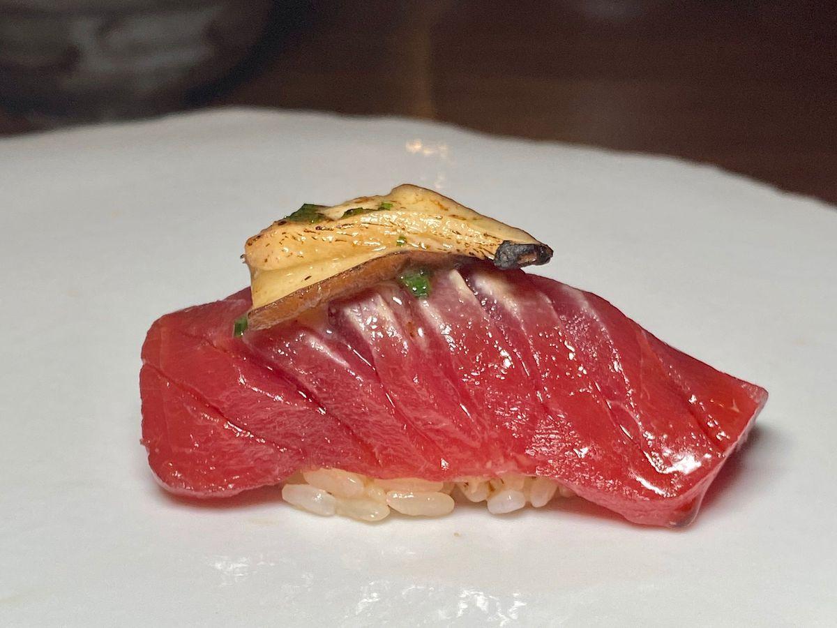 a piece of tuna nigiri at kissaki