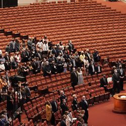 A few hundred invited attendees sing a congregational hymn during the 191st Semiannual General Conference of The Church of Jesus Christ of Latter-day Saints at the Conference Center in Salt Lake City on Saturday, Oct. 2, 2021.