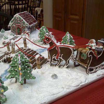 Gingerbread sleigh, reindeer, and Christmas trees.