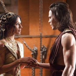 """In this film image released by Disney, Lynn Collins portrays Dejah Thoris, left, and Taylor Kitsch portrays John Carter in a scene from """"John Carter."""""""