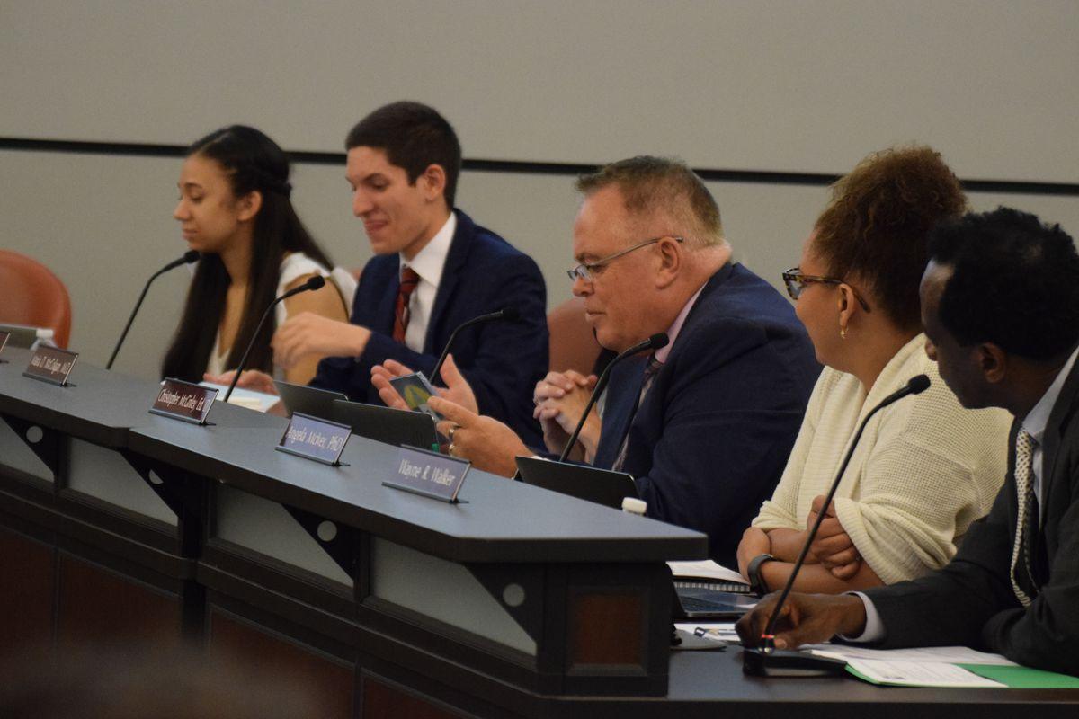 School board member Chris McGinley speaks during a school board meeting May 30