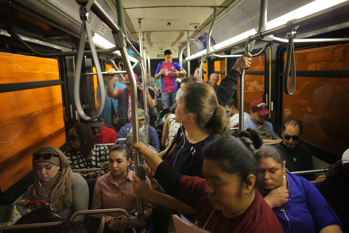 Riders on a crowded bus.