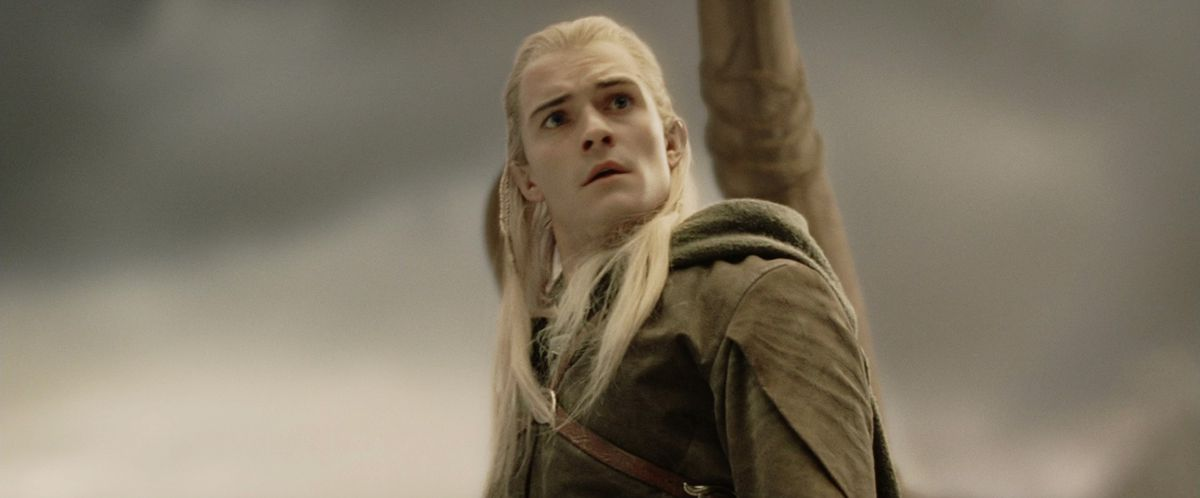 Legolas finishes his slide down the mumakil's trunk and looks confused.