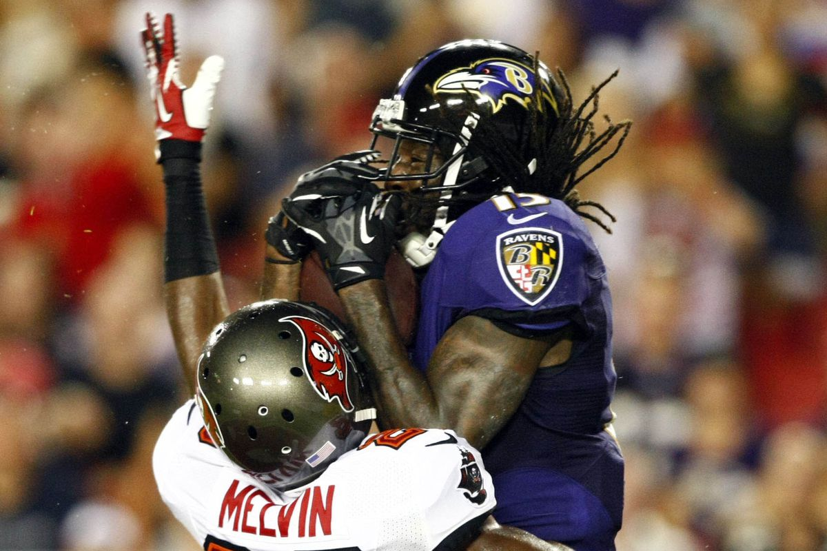 Ravens' WR LaQuan Williams catching a touchdown pass over a Buccaneers' defender on Thursday night.