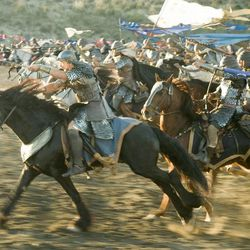 """Christian Bale (on the horse in the foreground) as Moses leads the Egyptians into battle in """"Exodus: Gods and Kings."""""""
