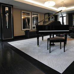 This  Friday, March, 16, 2012 photo shows a reception room with baby grand piano and large desk in one of the five bedroom luxury penthouse apartments overlooking Hyde Park, London which is available for hire during the London 2012 Olympics.
