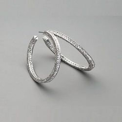 """<strong>Adriana Orsini</strong> 1.5"""" Pave Hoop Earrings, <a href=""""http://www.saksfifthavenue.com/main/ProductDetail.jsp?PRODUCT%3C%3Eprd_id=845524445498237&FOLDER%3C%3Efolder_id=282574492710955&bmUID=kafUYVY&site_refer=EML1147A"""">$75</a> at Saks Fifth Aven"""