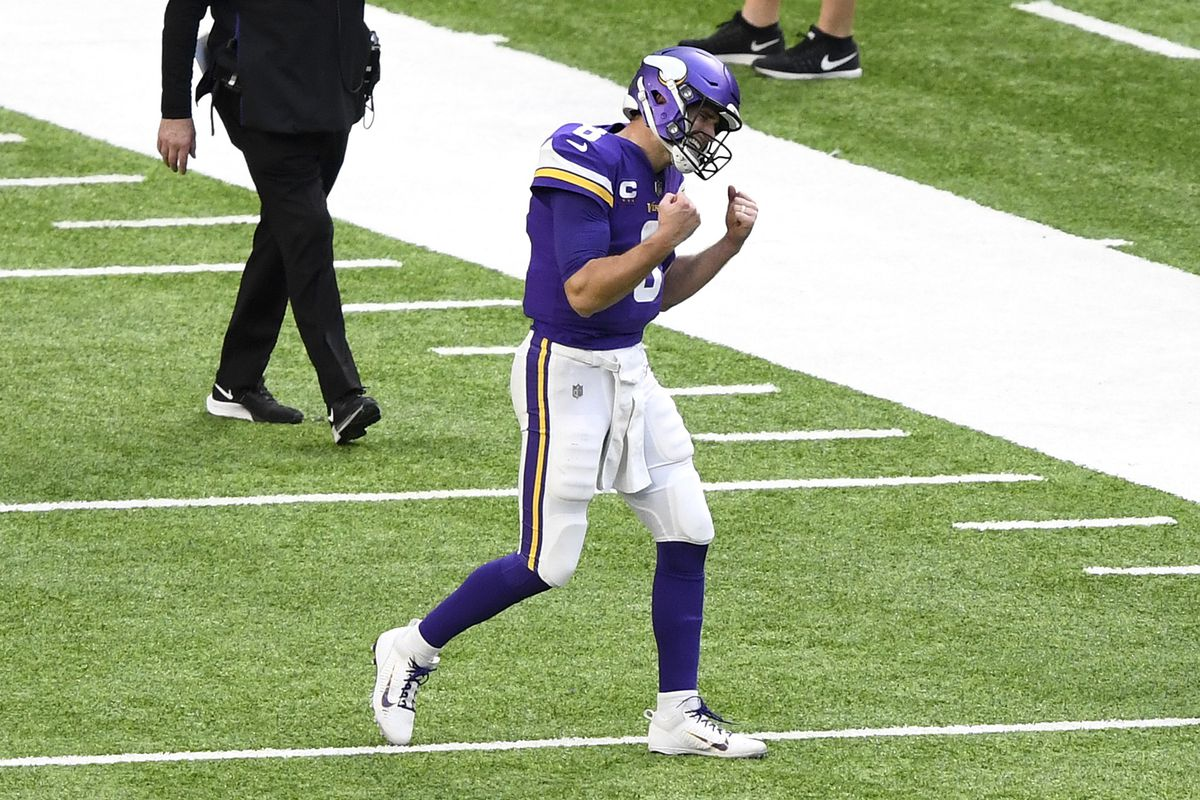 Kirk Cousins #8 of the Minnesota Vikings reacts during the third quarter against the Chicago Bears at U.S. Bank Stadium on December 20, 2020 in Minneapolis, Minnesota.