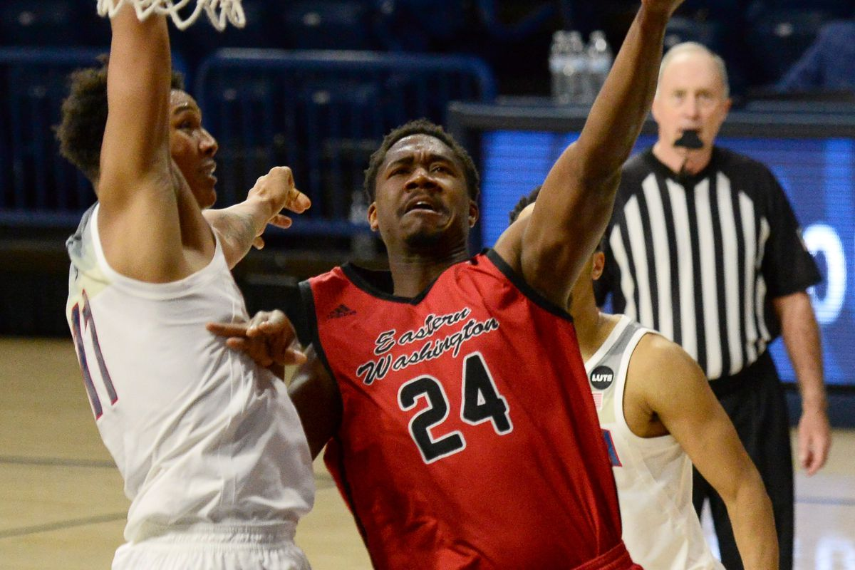 Eastern Washington Eagles guard Kim Aiken Jr. goes up for a layup against Arizona Wildcats forward Ira Lee during the second half at McKale Center.